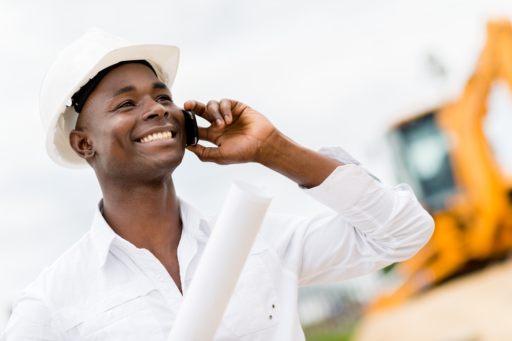 Architect making business call at a construction site